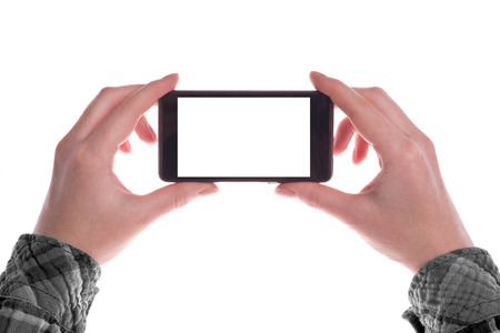photo backdrop: Hands holding Mobile Smartphone Device in Vertical Position with Blank White Screen as Copy Space isolated on white background