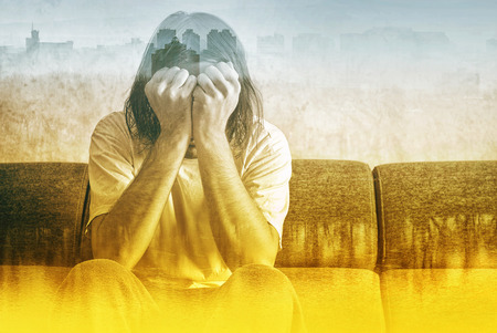 depression: Social Alienation Concept, Depressed Man covering face and crying in despair. Stock Photo