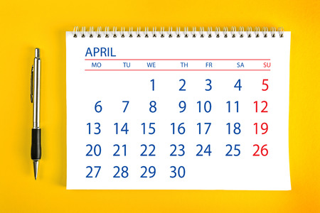 spiral binding: April Paper Calendar Page with Spiral Binding as Time Management and Schedule Concept.