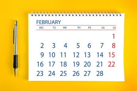 spiral binding: February Paper Calendar Page with Spiral Binding as Time Management and Schedule Concept.
