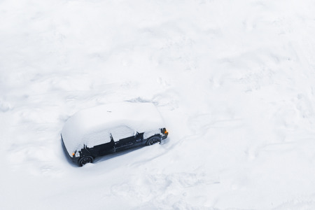 Car Trapped in Deep Snow Build-up after a Blizzard or Big Snow Storm