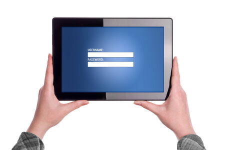 internet safety: Hands holding Digital Tablet Computer with Login Web Page Form displayed Stock Photo
