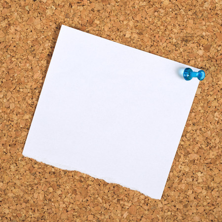 imply: Blank Paper Reminder Note Pinned to a Cork Memory Bulletin Board as Copy Space for Your Message