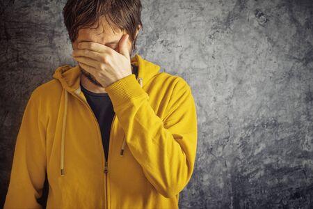 yellow jacket: Adult Man with Chronic Migraine Headache Wearing Yellow Jacket.
