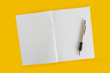 ballpoint pen: Ballpoint Pen and Blank Paper Notebook on Yellow Background.