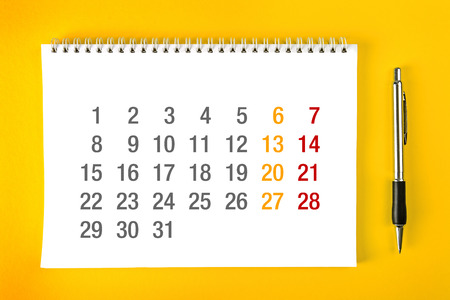 spiral binding: Paper Calendar Page with Spiral Binding as Time Management and Schedule Concept.
