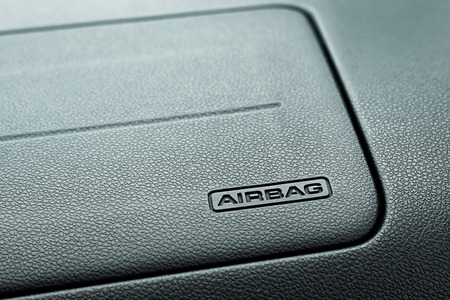 compartment: Airbag Symbol on Car Compartment in front of the passenger seat. Stock Photo
