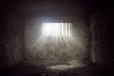 Compulsive Consumerism Concept, Empty Concrete Prison Cell with Barcode shaped Window. Sun rays and sun flare through the prison bars.