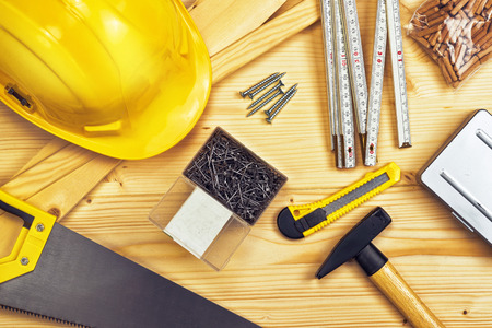 woodworker: Assorted Woodwork and Carpentry or Construction Tools on Pine Wood Texture Background.