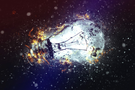 concept and ideas: Exploding Light Bulb as Conceptual image for New Ideas and Brainstorming. Stock Photo