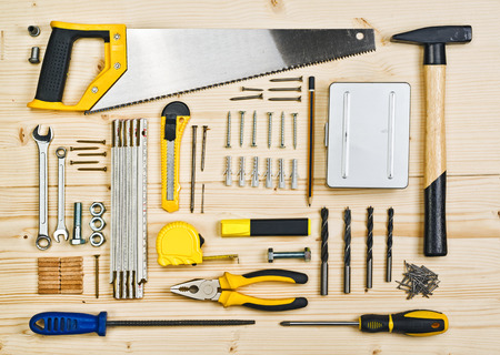 Assorted Woodwork and Carpentry or Construction Tools on Pine Wood Texture Background.