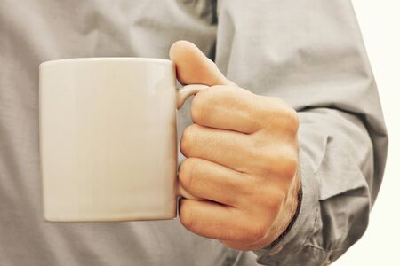 cup coffee: Businessman with white coffee cup, refreshment and morning coffee break in the office during working hours.