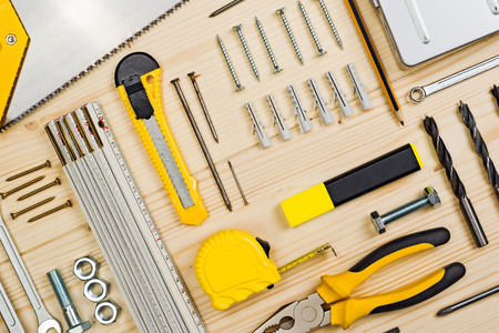 organized group: Assorted Woodwork and Carpentry or Construction Tools on Pine Wood Texture Background.