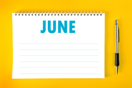 spiral binding: June Paper Calendar Blank Page with Spiral Binding as Time Management and Schedule Concept. Stock Photo