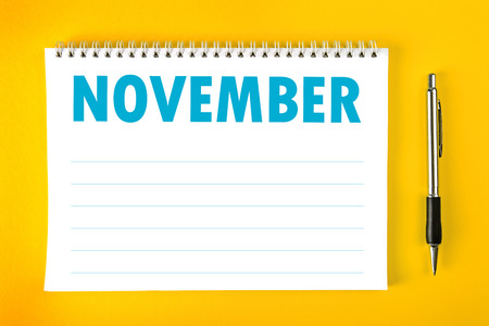 November Paper Calendar Blank Page with Spiral Binding as Time Management and Schedule Concept. Stock Photo