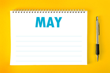 binding: May Paper Calendar Blank Page with Spiral Binding as Time Management and Schedule Concept. Stock Photo