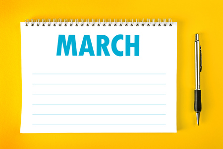 spiral binding: March Paper Calendar Blank Page with Spiral Binding as Time Management and Schedule Concept. Stock Photo