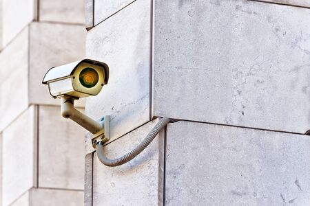big brother: Security CCTV camera mounted on the building wall as apart of private property protection system or Big Brother Concept Stock Photo