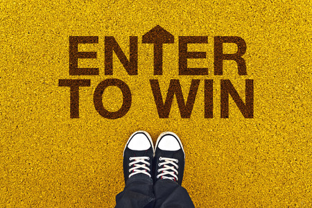 sweepstake: Enter To Win on Asphalt Road, Man standing Above the Title Ready to Walk. Stock Photo