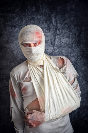 injurious: Injured Mad with Brain Concussion and Wounded Head wearing Medical Bandages.