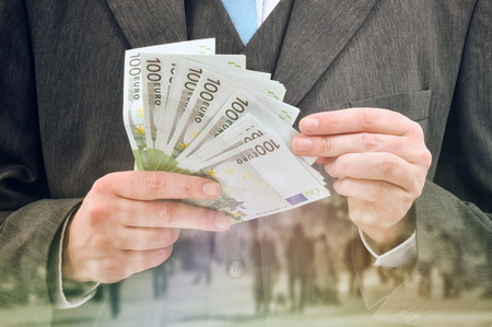 eur: Bank Officer Providing Service of Installment Loan in Cash, Euro Banknotes. Stock Photo