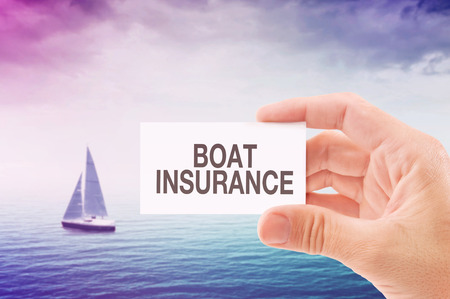 on boat: Boat Insurance Agent Holding Business Card, Sailing Boat on Open Sea in Background.