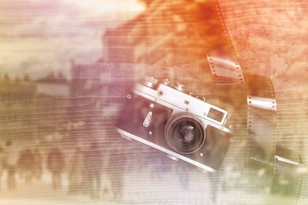 overexposed: Retro style vintage photography camera on a wooden table plate with overexposed film strip