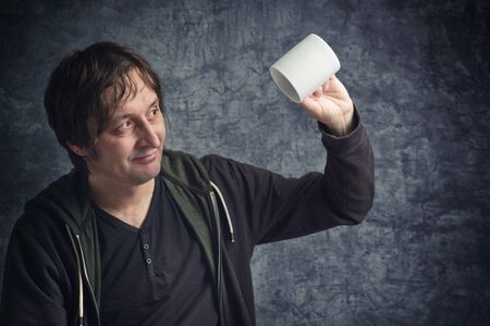 expectations: Disappointed Man Looking at Empty Cup, Concept of Failure of Expectations.