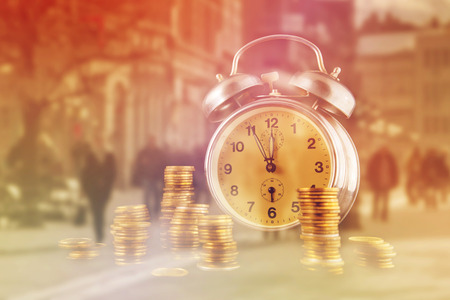 coin stack: Golden coin stack and vintage clock as Money Saving Concept