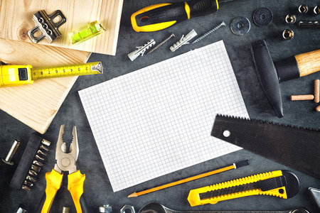 Assorted Do It Yourself DIY Tools and Blank Page Notebook as Copy Space for Home Improvement Project Planning or any Other Workshop Message.