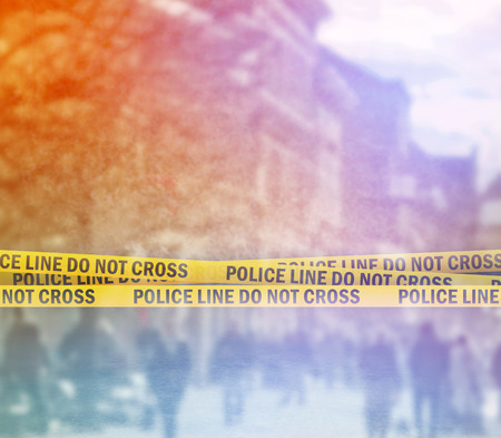 Police Line Do Not Cross Yellow Headband Tape, Crime Scene on the Street Stock Photo