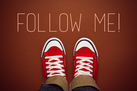 networking: Follow Me Request Concept for Social Networking on Internet with Young Person in Red Sneakers from Above. Stock Photo