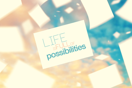 possibilities: Life is Full of Possibilities Inspirational Quote on Vintage Paper Floating on The Wind in The Air, Retro Instagram Like Filter Toned Image. Stock Photo