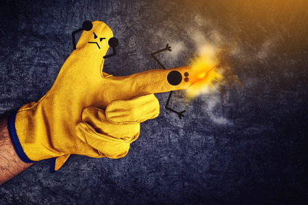 outrage: Funny Smileys on Fingers in Protective Yellow Working Gloves, Gun Fire Accident Concept