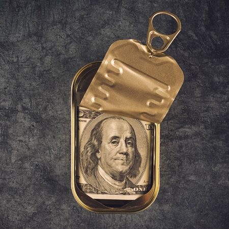 sardine can: Hundered American Dollar Bill in Open Empty Sardine Fish Tin Can on Grunge Gray Background, Top View Stock Photo