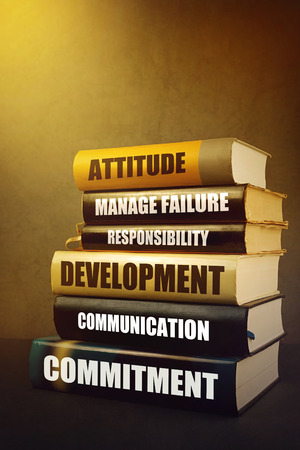 characteristics: Business Leader Attributes, Traits, Characteristics and Features in Education Literature, Mastering Leadership Concept with Stack of Published Books.