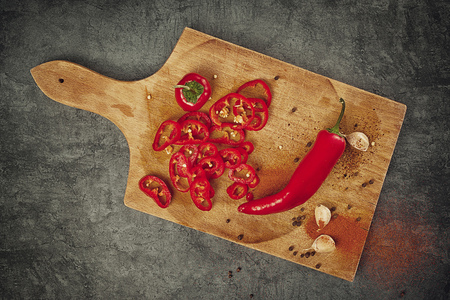 zesty: Red Hot Chili Pepper, Spice and Organic Garlic on Wooden Kitchen Plate as Hot Food Ingredients for Spicy Piquant Cuisine, Top View