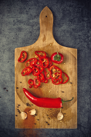 piquant: Red Hot Chili Pepper, Spice and Organic Garlic on Wooden Kitchen Plate as Hot Food Ingredients for Spicy Piquant Cuisine, Top View