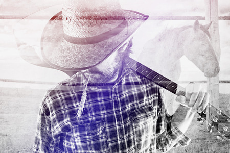 western clothing: Bearded Cowboy Farmer with Acoustic Blues Guitar and Straw Hat on Western American Horse Ranch, Double Exposure Image.