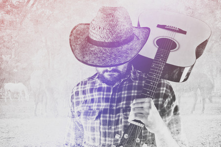 west country: Bearded Cowboy Farmer with Acoustic Blues Guitar and Straw Hat on Western American Horse Ranch, Double Exposure Image.