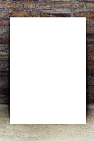 portfolio: Blank White Paper Poster Leaning on Old Brick Wall as Copy Space for Mockup Portfolio Design Stock Photo