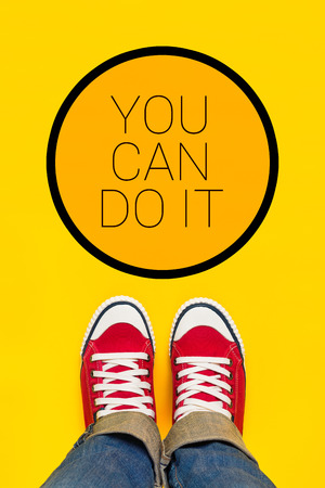 do it: You Can Do It Motivational Message, Teenage Person in Red Sneakers Standing in Front of Inspirational Sign, Top View