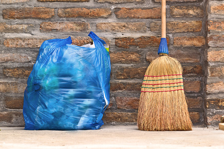 Household Used Broom For Floor Dust Cleaning and Blue Plastic Garbage Bag, Horizontal