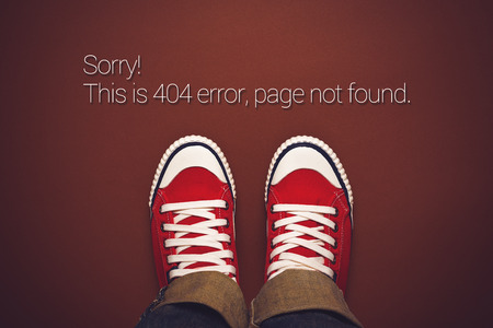 error message: Top View of 404 Error, Page Not Found, Person in Red Sneakers Standing on Brown Background with Internet Error Message