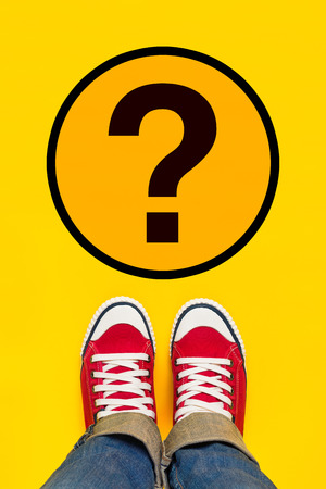 adulthood: So Many Questions on Young Person Path to Growing Up with Red Sneakers from Above, Top View