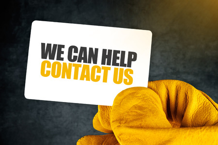 contact person: We Can Help, Contact Us on Business Card, Male Hand in Yellow Leather Construction Working Protective Gloves Holding Card with Rounded Corners. Stock Photo