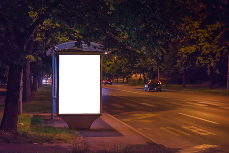 Blank Bus Station Billboard at Night as Copy Space Ready for Mock Up Design