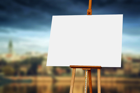 Wooden Easel with Blank Painting Canvas as Copy Space for Mock Up Painting