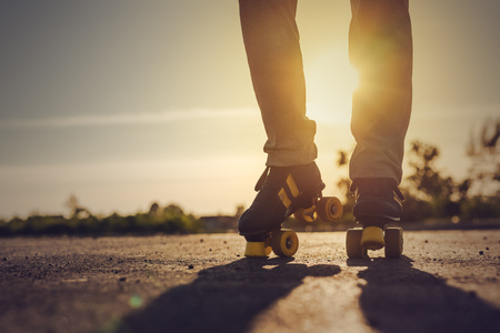 roller skates: Woman Riding Roller Skates in Urban Environment in Sunset, Selective Focus Toned Image.
