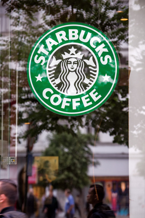 starbucks coffee: PRAGUE CZECH REPUBLIC  MAY 25 2015: Starbucks Coffee logo in Prague restaurant shop window. Starbucks is the largest coffeehouse company in the world with stores in more than 60 countries. Editorial